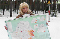 Belarus/Weissrussland, 2005/03/23<br /> BYKHOV. Julia (18) shows a map of radioactive contaminated areas of the Republic of Belarus in front of the radioactive sign that indicates a closed forest near to the small town of Bykhov (region of Mogilev) where Julia lives. More than one quarter of Belarus has been heavily contaminated by fallout from the Chernobyl catastrophe.<br /> ? Vaclav Vasku/EST&OST