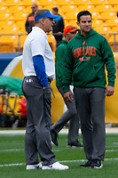 Pitt head coach Pat Narduzzi (left) and Miami Hurricanes head coach Manny Diaz meet before the game. The Miami Hurricanes football team defeated the Pitt Panthers 16-12 in a game at Heinz Field, Pittsburgh, Pennsylvania on October 26, 2019.