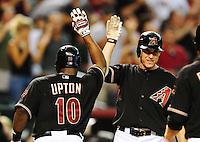 Aug. 21, 2010; Phoenix, AZ, USA; Arizona Diamondbacks outfielder Justin Upton (left) is congratulated by second baseman Kelly Johnson after hitting a two run home run in the sixth inning against the Colorado Rockies at Chase Field. Mandatory Credit: Mark J. Rebilas-