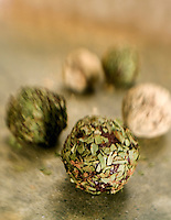 Chocolate Truffles on golden green rolles in Thyme