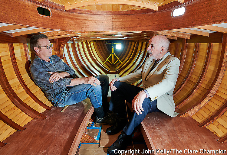 Steve Morris and Fionan de Barra in Naneen's restored interior. Despite the sparse comfort and limited headroom, several of the boats were used for cruising in the early years of the class. Photo John Kelly/Clare Champion