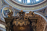 The altar and Bernini's Baldacchino in bronze in St Peters Basilica Church, Vatican City, Rome Italy