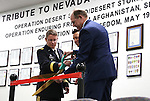From left, Gen. Mike Hanifan, Gov. Brian Sandoval and Adjutant General Brig. Gen. Bill Burks cut a ribbon during a Nevada National Guard Combat Veterans Remembrance Day ceremony at the Office of the Adjutant General in Carson City, Nev., on Friday, April 17, 2015. A tribute wall with the names of about 2,700 Nevada National Guard Soldiers and Airmen deployed into combat zones since Sept. 11, 2001 was unveiled. <br /> Photo by Cathleen Allison