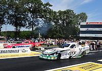 Jun. 3, 2012; Englishtown, NJ, USA: NHRA funny car driver Mike Neff (near lane) races alongside Bob Tasca III during the Supernationals at Raceway Park. Mandatory Credit: Mark J. Rebilas-