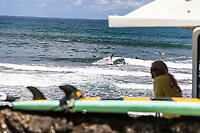 Surfers at Honoli'i Beach Park and Bay, Hilo, Big Island.