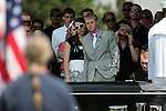An estimated 500 people attended a memorial service for Colorado shooting victim Jonathan Blunk, in Reno, Nev. on Friday morning, Aug. 3, 2012. (AP Photo/Cathleen Allison)