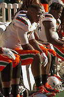 Miami linebacker Shaquille Quarterman (55) sits on the bench as his team gets upset. The Pitt Panthers upset the undefeated Miami Hurricanes 24-14 on November 24, 2017 at Heinz Field, Pittsburgh, Pennsylvania.