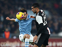 Football, Serie A: S.S. Lazio - Juventus Olympic stadium, Rome, December 7, 2019. <br /> Juventus' Emre Can (r) in action with Lazio's Marco Parolo (l) during the Italian Serie A football match between S.S. Lazio and Juventus at Rome's Olympic stadium, Rome on December 7, 2019.<br /> UPDATE IMAGES PRESS/Isabella Bonotto