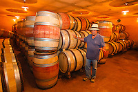 """Israel,nord Judee,Ramat Raziel, mr Eli Gilbert ben-Zaken shows the wine casks in the cellar of is winery """"Domane du Castel"""""""