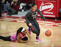 Jailyn Mason, with the University of Arkansas Razorback Women's basketball team, dribbles the ball around Caitlin McGee, with the University of University of Mississippi Friday, February 19, 2021, at Bud Walton Arena on the campus of the University in Fayetteville. Check out nwaonline.com/210220Daily/ and nwadg.com/photos for a photo gallery.<br /> (NWA Democrat-Gazette/David Gottschalk)