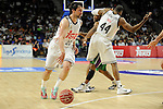 Real Madrid´s Sergio Llull and Marcus Slaughter during 2014-15 Liga Endesa match between Real Madrid and Unicaja at Palacio de los Deportes stadium in Madrid, Spain. April 30, 2015. (ALTERPHOTOS/Luis Fernandez)