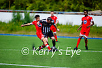 Tommy McCarthy of Strand Road tussling with Tennyson Obegbare of Dynamos during their encounter in the Senior soccer league on Sunday