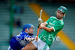 Evan Boyle, Ballyduff, in action against Fionan Egan, Saint Brendans, during the Kerry County Minor Hurling final at Austin Stack Park on Saturday.