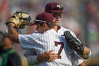 Mississippi State outfielder Hunter Renfro (34) hugs Bulldog teammate Jacob Robson (7) before the start of Game 1 of the 2013 Men's College World Series Finals against the UCLA Bruins on June 24, 2013 at TD Ameritrade Park in Omaha, Nebraska. The Bruins defeated the Bulldogs 3-1, taking a 1-0 lead in the best of 3 series. (Andrew Woolley/Four Seam Images)