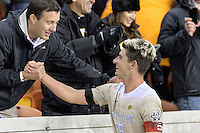 Houston, TX - Friday December 9, 2016: Ian Harkes (16) of the Wake Forest Demon Deacons is greeted by a fan after his goal defeated the Denver Pioneers at the NCAA Men's Soccer Semifinals at BBVA Compass Stadium in Houston Texas.