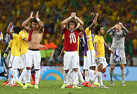 Brazil players applaud the supporters at full time