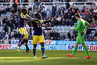 Pictured: Wilfried Bony (C) of Swansea celebrating his goal with team mate Marvin Emnes (L), he from the penalty spot after the former was brought dowin in the box in stoppage time. Saturday 19 April 2014<br /> Re: Barclay's Premier League, Newcastle United v Swansea City FC at St James Park, Newcastle, UK.