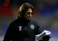 10th February 2021; Madejski Stadium, Reading, Berkshire, England; English Football League Championship Football, Reading versus Brentford; Brentford Manager Thomas Frank reading from his notes as he walks back into the tunnel at half time