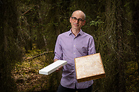 UAA associate professor of public health Philippe Amstislavski with examples of the lightweight packaging materials his team has developed using fungi, which they hope will replace Styrofoam.