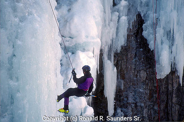 MAN SCALES ICE WALL