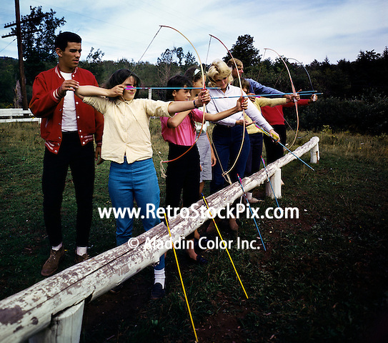 Children learning bow and arrow skill with trainer at the Victor Van's Hideaway Ranch / Shadow Mountain in East Jewett, New York