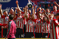 29th May 2021; Wembley Stadium, London, England; English Football League Championship Football, Playoff Final, Brentford FC versus Swansea City; Vitaly Janelt of Brentford lifts the Sky Bet EFL Championship Plays-off Trophy with his team mates after they won 2-0 and promoted to the premier league