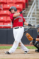 Vinny DiFazio #23 of the Hickory Crawdads follows through on his swing against the Kannapolis Intimidators at  L.P. Frans Stadium August 1, 2010, in Hickory, North Carolina.  Photo by Brian Westerholt / Four Seam Images