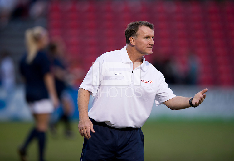 Virginia head coach Steve Swanson talks to his team before the game in College Park, MD.  Maryland defeated Virginia, 3-1.