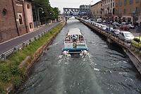 - Milan, boat navigating on Naviglio Grande channel....- Milano, battello in navigazione sul Naviglio Grande