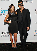 HOLLYWOOD, LOS ANGELES, CA, USA - OCTOBER 30: Courtney Laine Mazza, Mario Lopez arrive at UNICEF's Next Generation's 2nd Annual UNICEF Masquerade Ball held at the Masonic Lodge at the Hollywood Forever Cemetery on October 30, 2014 in Hollywood, Los Angeles, California, United States. (Photo by Rudy Torres/Celebrity Monitor)