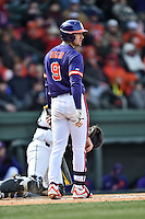 Clemson Tigers right fielder Steven Duggar (9) checks for signals during a game against the South Carolina Gamecocks at Fluor Field February 28, 2015 in Greenville, South Carolina. The Gamecocks defeated the Tigers 4-1. (Tony Farlow/Four Seam Images)