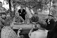 """Russia. Krasnodar Krai Region. Krasnodar. Workers play dominoes at a wooden table together during their lunch break. They all work in a new large private farm on what used to be a sovkhoz farm. A sovkhoz was a form of state-owned farm in the Soviet Union. It is usually contrasted with kolkhoz, which is a collective-owned farm. Unlike the members of a kolkhoz, which were called """"kolkhozniks"""" or """"kolkhozniki"""" (the workers of a sovkhoz were only colloquially called """"sovkhozniki"""". Krasnodar (also known as Kuban) is the largest city and the administrative centre of Krasnodar Krai in Southern Russia. 21.09.1993 © 1993 Didier Ruef"""