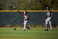 St. Bonaventure Bonnies center fielder Taishi Terashima (1) throws the ball in after making a diving attempt as left fielder Sam Fuller (9) looks on during a game against the Dartmouth Big Green on February 25, 2017 at North Charlotte Regional Park in Port Charlotte, Florida.  St. Bonaventure defeated Dartmouth 8-7.  (Mike Janes/Four Seam Images)