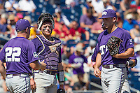 TCU Horned Frogs catcher Evan Skoug (9) and pitcher Jared Janczak (41) wait for head coach Jim Schlossnagle (22) to walk to the mound during the NCAA College World Series on June 19, 2016 at TD Ameritrade Park in Omaha, Nebraska. TCU defeated Texas Tech 5-3. (Andrew Woolley/Four Seam Images)
