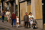 Miners strike 1984 Boarded up shops in the pit village of Shirebrook Derbyshire 1980s UK Working Class community, families going shopping.