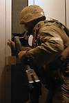 AR RUTBAH, Iraq- Lance Cpl. Jake Parker from 2D Platoon, Charlie Company, Light Armored Reconnaissance uses a breaching tool to enter a home in a small village outside of Ar Rutbah during a raid. The Marines of Regimental Combat Team 2 conduct counter-insurgency operations with Iraqi Security Forces to isolate and neutralize anti-Iraqi forces, to support the continued development of Iraqi Security Forces, and to support Iraqi reconstruction and democratic elections in order to create a secure environment that enables Iraqi self-reliance and self-governance. (Official USMC photo by Lance Cpl. Shane S. Keller)