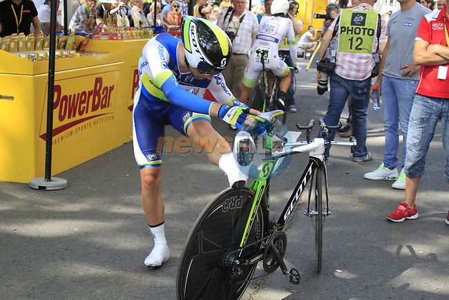 Michael Albasini (SUI) Orica GreenEdge stretches as he waits his turn during the Prologue of the 99th edition of the Tour de France 2012, a 6.4km individual time trial starting in Parc d'Avroy, Liege, Belgium. 30th June 2012.<br /> (Photo by Eoin Clarke/NEWSFILE)