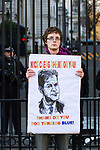 """© Joel Goodman - 07973 332324 . 09/12/2010 . London , UK . A man with a placard with a caricature of Nick Clegg and the words """" Nick Clegg Shame on you shame on you for turning blue """" standing at the gates of Downing Street . Students and their supporters demonstrate in Parliament Square in London against government cuts to student support , Educational Maintenance Allowance ( EMA ) and rising university tuition fees . Photo credit : Joel Goodman"""