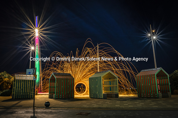 """Pictured:  Southend on Sea<br /> <br /> Amazing photos show sparks illuminating British landmarks as they fly from what appears to be a disc of colourful light.  This unique effect is the result of long-exposure night-time shots of a whisk stuffed with steel wool, which is set alight and spun at the end of a metal chain.<br /> <br /> Amateur photographer Dmitrij Dimek is passionate about what he calls 'light paintings', and took these photos at castles, beaches and other settings around Essex and London.  The 38 year old, who grew up in Poland but now lives in Southend-on-Sea, Essex, said: """"When I first found out about light painting with steel wool, I thought it was an outstanding way to connect with photography.  SEE OUR COPY FOR DETAILS.<br /> <br /> Please byline: Dmitrij Dimek/Solent News<br /> <br /> © Dmitrij Dimek/Solent News & Photo Agency<br /> UK +44 (0) 2380 458800"""