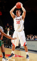 CHARLOTTESVILLE, VA- NOVEMBER 26:  Thomas Rogers #30 of the Virginia Cavaliers handles the ball during the game on November 26, 2011 at the John Paul Jones Arena in Charlottesville, Virginia. Virginia defeated Green Bay 68-42. (Photo by Andrew Shurtleff/Getty Images) *** Local Caption *** Thomas Rogers