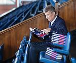 Sandy Jardine reading copies of a Bill Struth book on a visit to Ibrox Stadium
