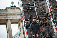 """Die temporaeren Skulptur """"Monument"""" von Manaf Halbouni auf dem Platz des 18. Maerz vor dem Brandenburger Tor.<br /> Im Rahmen des 3. Berliner Herbstsalons<br /> Mit Manaf Halbouni (Kuenstler), Kultursenator Dr. Klaus Lederer (Schirmherr der Skulptur Monument) und Shermin Langhoff (Intendantin Maxim Gorki Theater) wurde am Freitag den 10 November 2017 die Skultur vor dem Brandenburger Tor der Oeffentlichkeit vorgestellt.<br /> Im Bild: Manaf Halbouni.<br /> 10.11.2017, Berlin<br /> Copyright: Christian-Ditsch.de<br /> [Inhaltsveraendernde Manipulation des Fotos nur nach ausdruecklicher Genehmigung des Fotografen. Vereinbarungen ueber Abtretung von Persoenlichkeitsrechten/Model Release der abgebildeten Person/Personen liegen nicht vor. NO MODEL RELEASE! Nur fuer Redaktionelle Zwecke. Don't publish without copyright Christian-Ditsch.de, Veroeffentlichung nur mit Fotografennennung, sowie gegen Honorar, MwSt. und Beleg. Konto: I N G - D i B a, IBAN DE58500105175400192269, BIC INGDDEFFXXX, Kontakt: post@christian-ditsch.de<br /> Bei der Bearbeitung der Dateiinformationen darf die Urheberkennzeichnung in den EXIF- und  IPTC-Daten nicht entfernt werden, diese sind in digitalen Medien nach §95c UrhG rechtlich geschuetzt. Der Urhebervermerk wird gemaess §13 UrhG verlangt.]"""