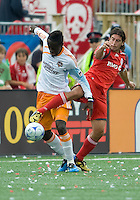 18 July 2009: Houston Dynamo forward Kei Kamara #10 and Toronto FC defender Nick Garcia #6 battle for a ball in a game between the Toronto FC and Houston Dynamo..The game ended in a 1-1 draw..
