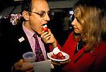 Belgravia Street party Motcombe Street London Uk eating strawberries and cream.