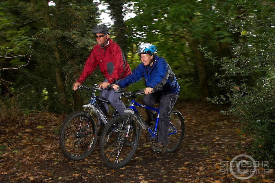 Troy and Florence Allport riding Kona bikes..Virginia Water , Surrey  October 2008..pic copyright Steve Behr / Stockfile