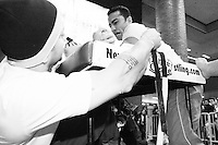"""Arm wrestlers compete at the Empire State Finals at the Port Authority Bus Terminal in New York City on November 17, 2005.  The Empire State Finals is the culmination in the year of the New York City Arm Wrestling Association's """"Golden Arm Series""""."""