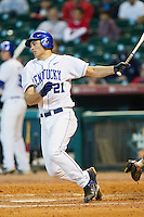 Luke Maile #21 of the Kentucky Wildcats follows through on his swing against the Houston Cougars at Minute Maid Park on March 5, 2011 in Houston, Texas.  Photo by Brian Westerholt / Four Seam Images