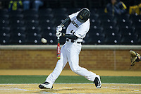 Jonathan Pryor (11) of the Wake Forest Demon Deacons makes contact with the baseball during the game against the Kent State Golden Flashes in game two of a double-header at David F. Couch Ballpark on March 4, 2017 in  Winston-Salem, North Carolina.  The Demon Deacons defeated the Golden Flashes 5-0.  (Brian Westerholt/Four Seam Images)