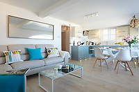 BNPS.co.uk (01202) 558833. <br /> Pic: KnightFrank/BNPS<br /> <br /> Pictured: Open plan living space/kitchen. <br /> <br /> The ultimate room with a view...<br /> <br /> A former fish cellar that is now an idyllic waterfront home overlooking a famous Cornish beach is on the market for £930,000.<br /> <br /> The ground floor apartment is in a prime frontline position with exceptional panoramic views over Porthmeor Beach and out to sea.<br /> <br /> Estate agent Christopher Bailey said the window in the reception space is like having your own live television screen looking out on the action of the beach.<br /> <br /> It has been designed and renovated to an exceptionally high standard and the immaculate flat is currently rented out for short holiday let, making about £40,000 profit a year.