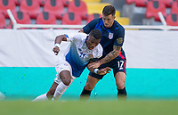 GUADALAJARA, MEXICO - MARCH 18: Aaron Herrera #17 of the United States battles with Luis Diaz #11 of Costa Rica during a game between Costa Rica and USMNT U-23 at Estadio Jalisco on March 18, 2021 in Guadalajara, Mexico.